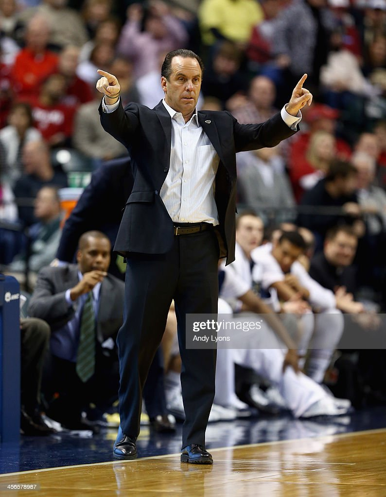 Mike Brey the head coach of the Notre dame Fighting Irish gives instructions to his team in the game against the Indiana Hoosiers during the 2013 Crossroads Classic at Bankers Life Fieldhouse on December 14, 2013 in Indianapolis, Indiana.