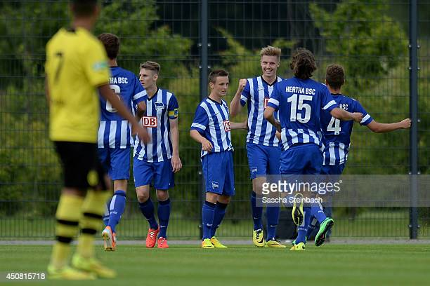 Mike Broehmer of Hertha BSC celebrates with team mates after scoring the opening goal during the B juniors bundesliga semi final match between...