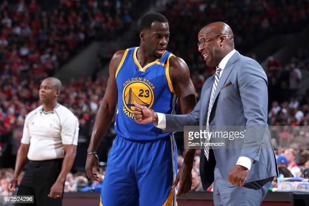 Mike Brown and Draymond Green of the Golden State Warriors talk during the game against the Portland Trail Blazers during Game Four of the Western...