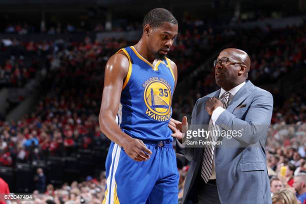 Mike Brown and Kevin Durant of the Golden State Warriors talk during the game against the Portland Trail Blazers during Game Four of the Western...