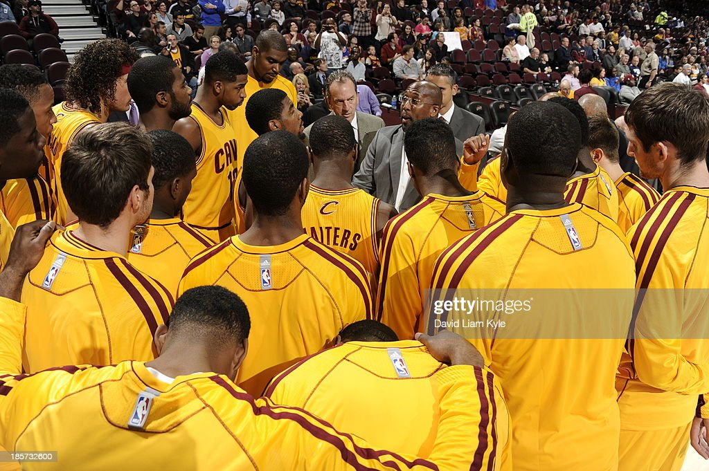 Mike Brown and the Cleveland Cavaliers huddle up before the game against the Milwaukee Bucks at The Quicken Loans Arena on October 8, 2013 in Cleveland, Ohio.