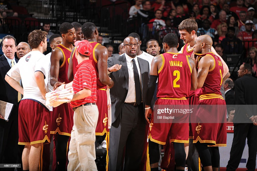Mike Brown Head Coach of the Cleveland Cavaliers talks with his players during the game against the Houston Rockets on February 1, 2014 at the Toyota Center in Houston, Texas.