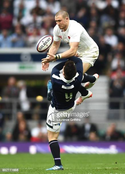 Mike Brown of England and Ali Price of Scotland battle to catch the ball during the RBS Six Nations match between England and Scotland at Twickenham...