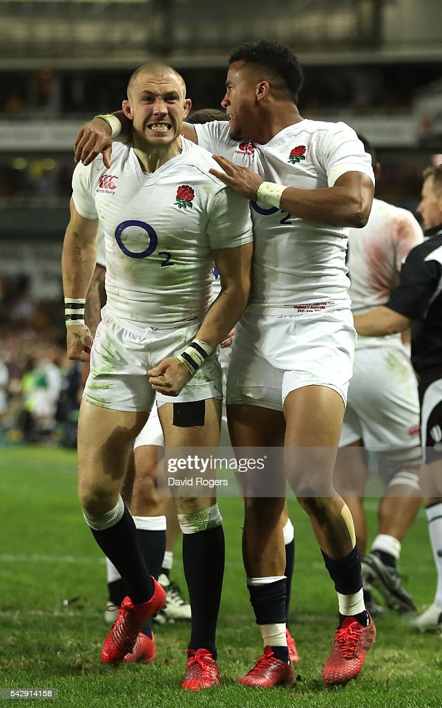 Mike Brown of England celebrates with team mate Anthony Watson (R) after scoring their second try during the International Test match between the Australian Wallabies and England at Allianz Stadium on June 25, 2016 in Sydney, Australia.