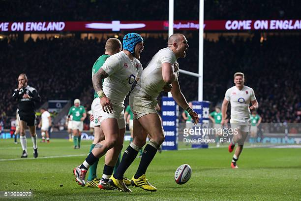 Mike Brown of England celebrates with teammate Jack Nowell of England after scoring his team's second try during the RBS Six Nations match between...