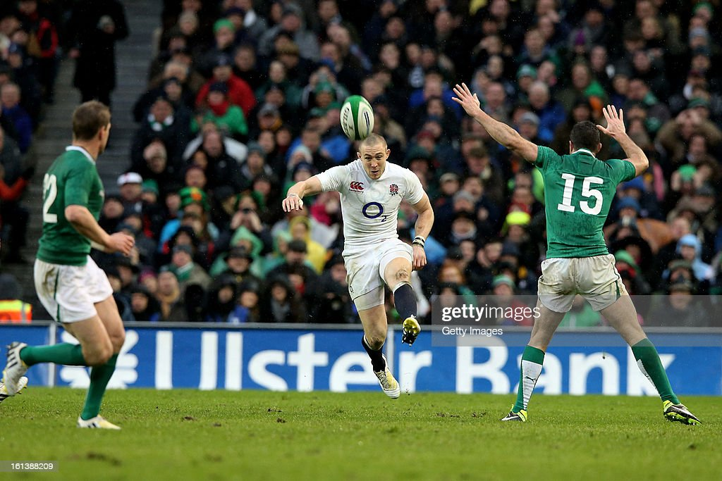 Mike Brown of England chips the ball over the Ireland defence during the RBS Six Nations match between Ireland and England at Aviva Stadium on February 10, 2013 in Dublin, Ireland.