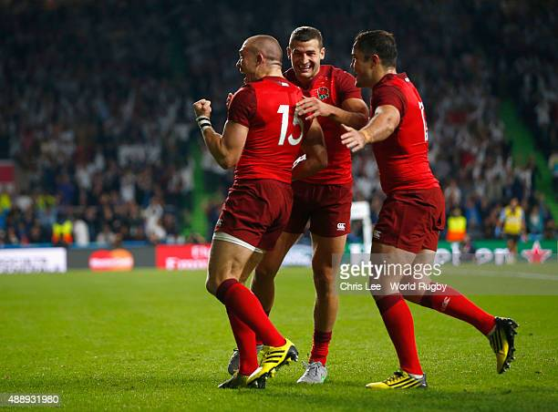 Mike Brown of England cleebrates scoring their second try with Jonny May and Brad Barritt of England during the 2015 Rugby World Cup Pool A match...