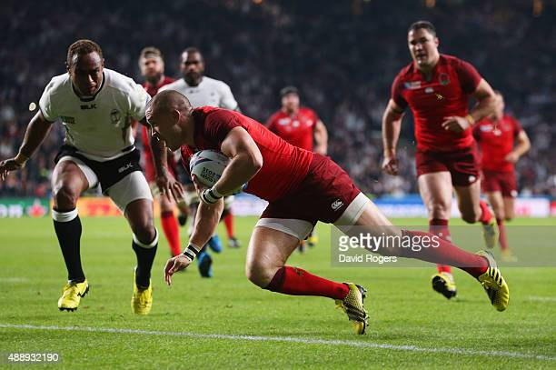 Mike Brown of England goes over to score the second try during the 2015 Rugby World Cup Pool A match between England and Fiji at Twickenham Stadium...