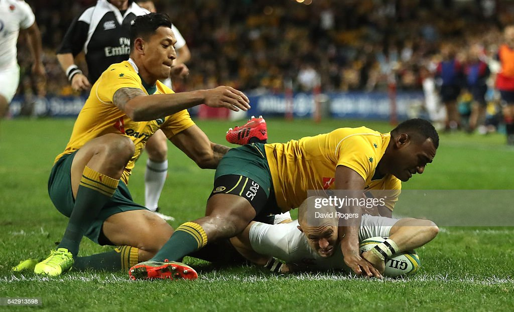 <a gi-track='captionPersonalityLinkClicked' href=/galleries/search?phrase=Mike+Brown+-+Rugby+Player&family=editorial&specificpeople=2385268 ng-click='$event.stopPropagation()'>Mike Brown</a> of England holds off <a gi-track='captionPersonalityLinkClicked' href=/galleries/search?phrase=Tevita+Kuridrani&family=editorial&specificpeople=7612194 ng-click='$event.stopPropagation()'>Tevita Kuridrani</a> and <a gi-track='captionPersonalityLinkClicked' href=/galleries/search?phrase=Israel+Folau&family=editorial&specificpeople=4194699 ng-click='$event.stopPropagation()'>Israel Folau</a> (L) to score their second try during the International Test match between the Australian Wallabies and England at Allianz Stadium on June 25, 2016 in Sydney, Australia.
