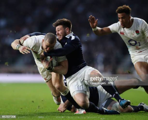 Mike Brown of England is tackled by Ali Price during the RBS Six Nations match between England and Scotland at Twickenham Stadium on March 11 2017 in...