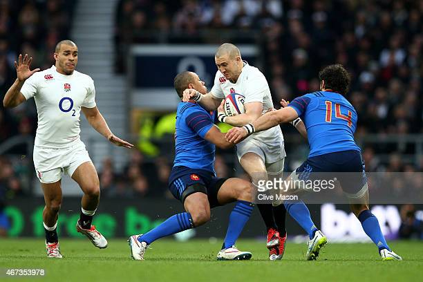 Mike Brown of England is tackled by Gael Fickou of France and Yoann Huget of France during the RBS Six Nations match between England and France at...