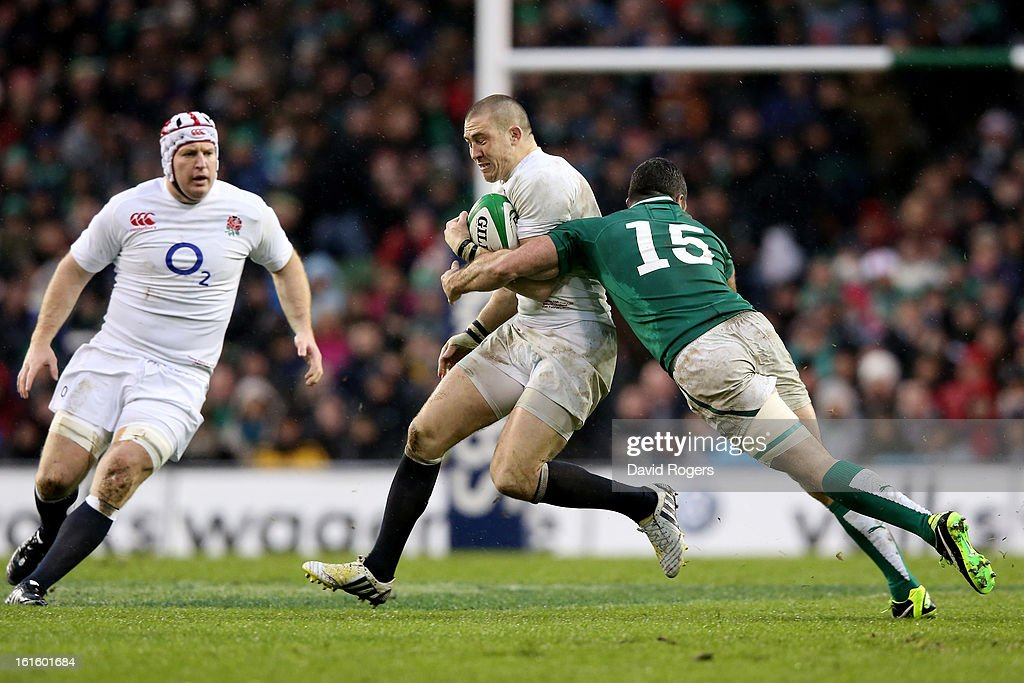 Mike Brown of England is tackled by Rob Kearney of Ireland during the RBS Six Nations match between Ireland and England at Aviva Stadium on February 10, 2013 in Dublin, Ireland.