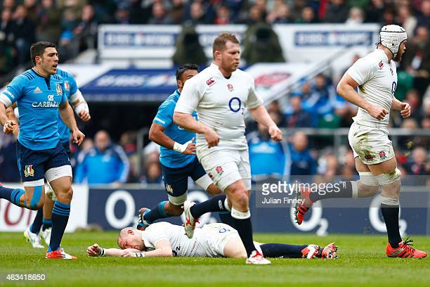 Mike Brown of England lies on the ground injured during the RBS Six Nations match between England and Italy at Twickenham Stadium on February 14 2015...