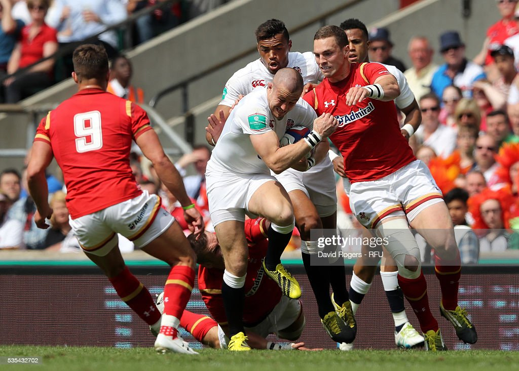 <a gi-track='captionPersonalityLinkClicked' href=/galleries/search?phrase=Mike+Brown+-+Rugby+Player&family=editorial&specificpeople=2385268 ng-click='$event.stopPropagation()'>Mike Brown</a> of England moves away from <a gi-track='captionPersonalityLinkClicked' href=/galleries/search?phrase=George+North&family=editorial&specificpeople=7320853 ng-click='$event.stopPropagation()'>George North</a> during the England v Wales International match at Twickenham Stadium on May 29, 2016 in London, England.