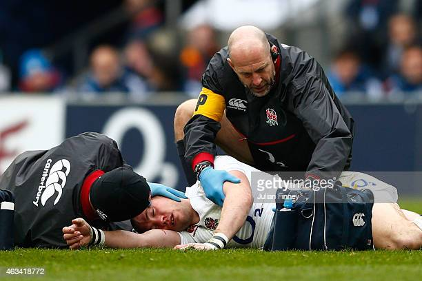 Mike Brown of England receives medical attention during the RBS Six Nations match between England and Italy at Twickenham Stadium on February 14 2015...
