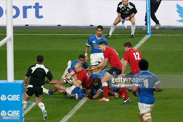 Mike Brown of England scores a try during the QBE international match between England and Samoa at Twickenham Stadium on November 22 2014 in London...