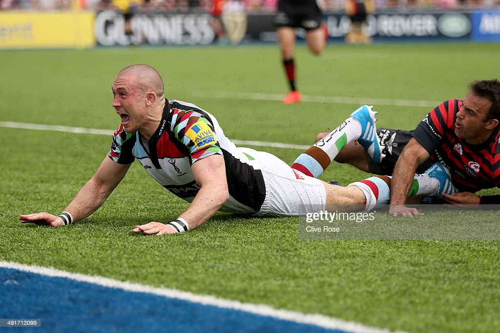 Mike Brown of Halrequins celebrates after scoring a try during the Aviva Premiership Semi Final match between Saracens and Harlequins at Allianz Park on May 17, 2014 in Barnet, England.
