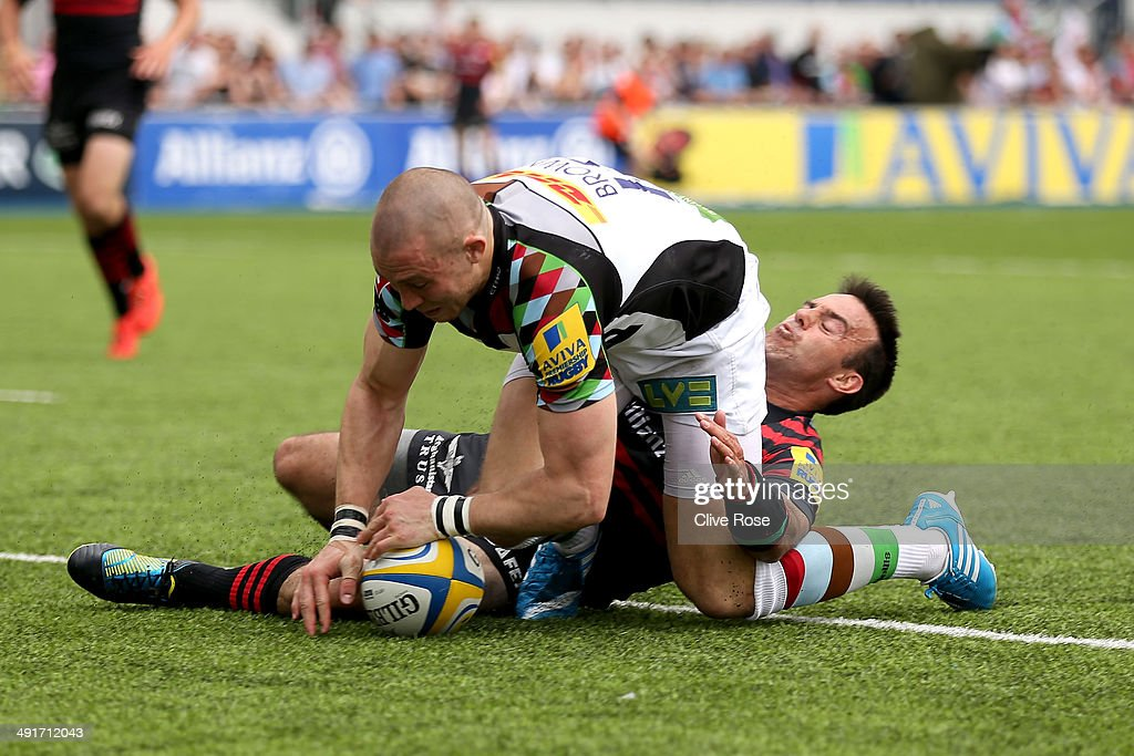 Mike Brown of Halrequins grounds the ball to score a try during the Aviva Premiership Semi Final match between Saracens and Harlequins at Allianz Park on May 17, 2014 in Barnet, England.