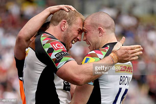 Mike Brown of Halrequins is congratuated by Chris Robshaw after scoring a try during the Aviva Premiership Semi Final match between Saracens and...