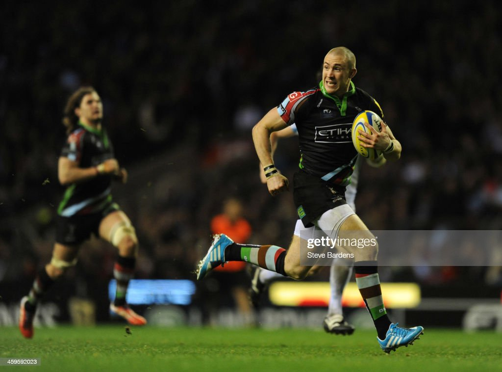 Mike Brown of Harlequins breaks away to score a try during the Aviva Premiership match between Harlequins and Exeter Chiefs at Twickenham Stadium on December 28, 2013 in London, England.