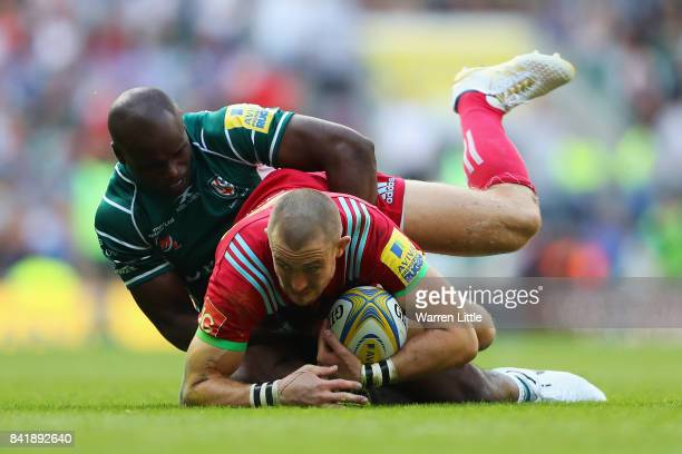 Mike Brown of Harlequins is tackled by Topsy Ojo of London Irish during the Aviva Premiership match between London Irish and Harlequins at Twickenham...