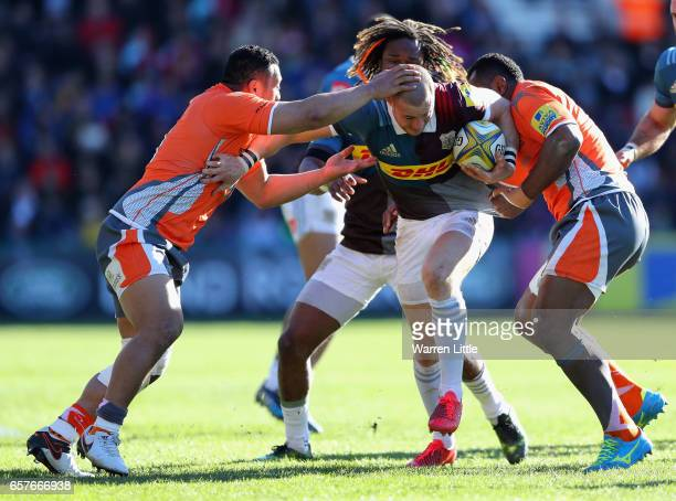 Mike Brown of Harlequins is tackled during the Aviva Premiership match between Harlequins and Newcastle Falcons at Twickenham Stoop on March 25 2017...