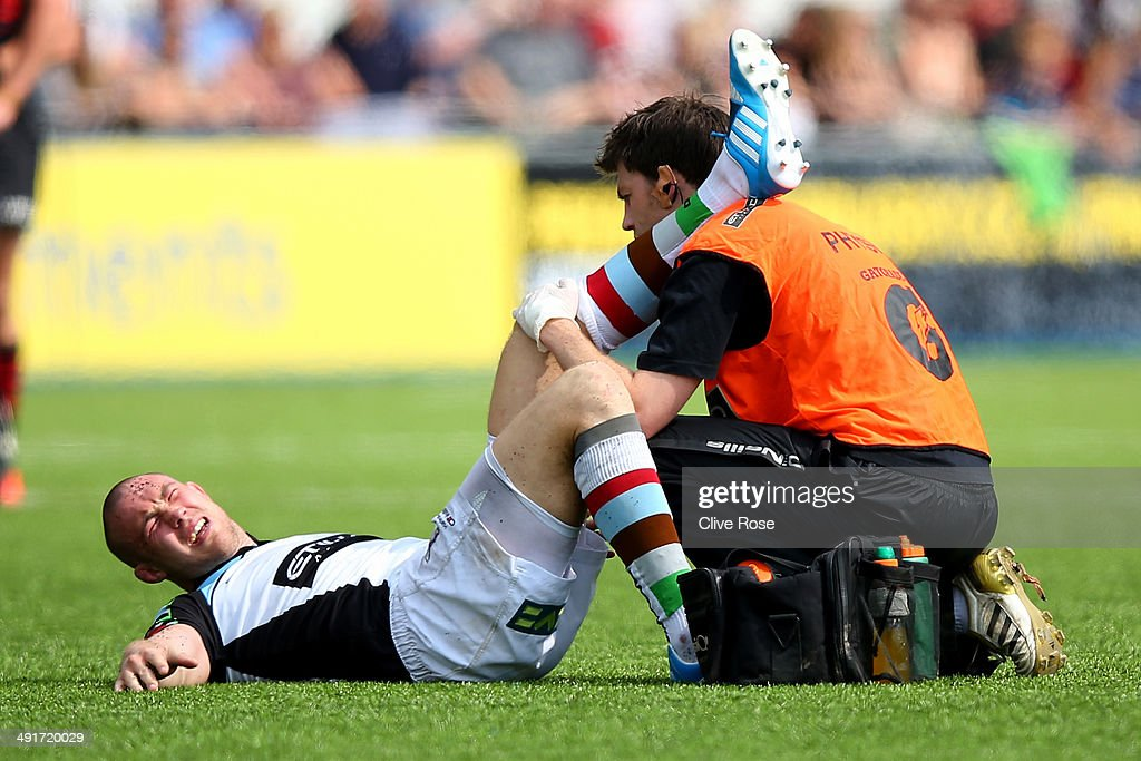 Mike brown of Harlequins receives treatment after a knock during the Aviva Premiership Semi Final match between Saracens and Harlequins at Allianz Park on May 17, 2014 in Barnet, England.