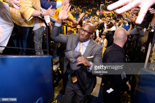 Mike Brown of the Golden State Warriors high fives fans as he walks off the court after winning Game Five of the 2017 NBA Finals against the...