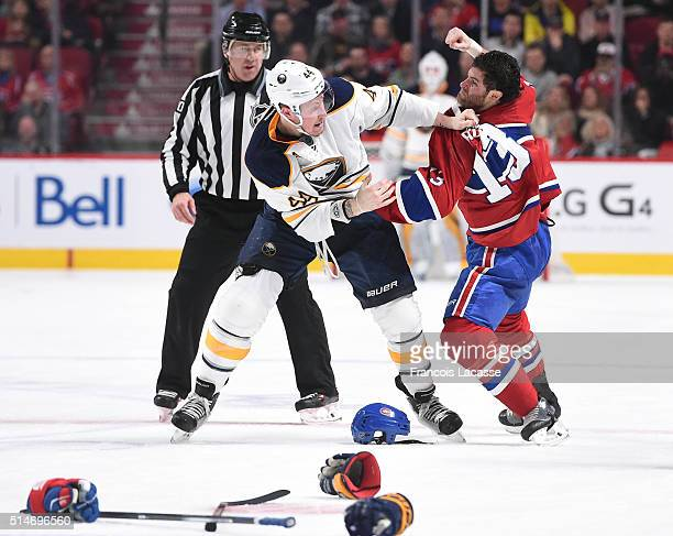 Mike Brown of the Montreal Canadiens and Nicolas Deslauriers of the Buffalo Sabres fight in the NHL game at the Bell Centre on March 10 2016 in...