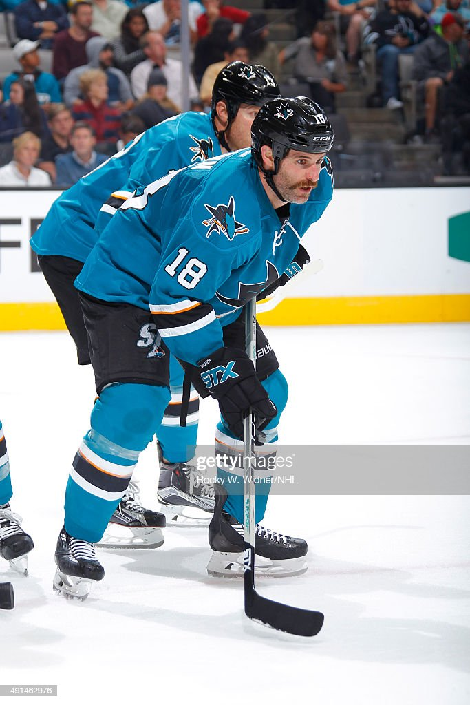 Mike Brown #18 of the San Jose Sharks faces off against the Vancouver Canucks at SAP Center on September 29, 2015 in San Jose, California.