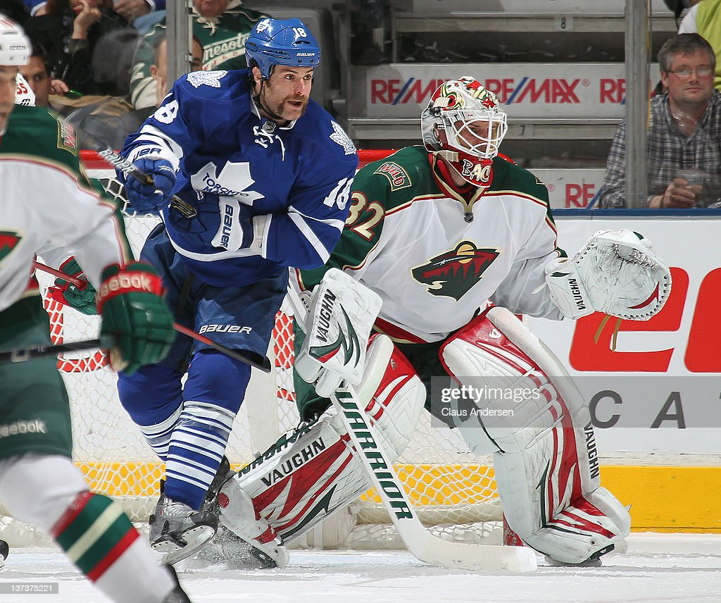 Mike Brown #18 of the Toronto Maple Leafs tries to disrupt Niklas Backstrom #32 of the Minnesota Wild in a game on January 19, 2012 at the Air Canada Centre in Toronto, Ontario, Canada. The Leafs defeated the Wild 4-1.