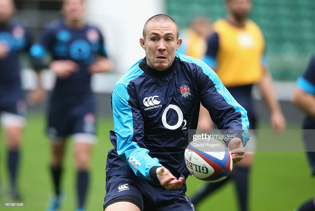 Mike Brown passes the ball during the England captain's run at Twickenham Stadium on November 8, 2013 in London, England.