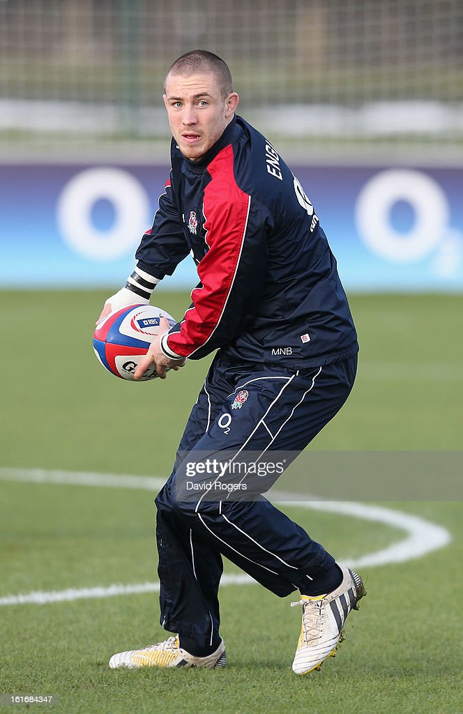 Mike Brown passes the ball during the England training session held at St Georges Park on February 14, 2013 in Burton-upon-Trent, England.