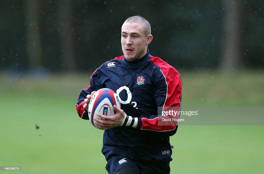 Mike Brown runs with the ball during the England training session held at Pennyhill Park on January 28, 2013 in Bagshot, England.