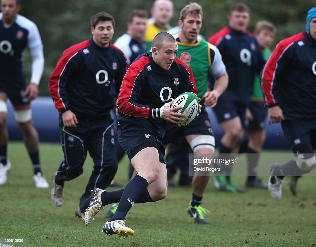 Mike Brown runs with the ball during the England training session held at Pennyhill Park on February 6, 2013 in Bagshot, England.
