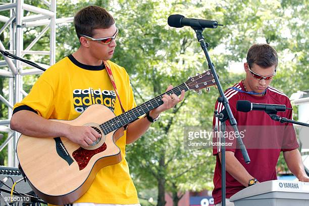 Mike Bryan and Bob Bryan of the band Bryan Brothers perform live for fans outdoors at the USTA National Tennis Center in Queens New York on August 24...