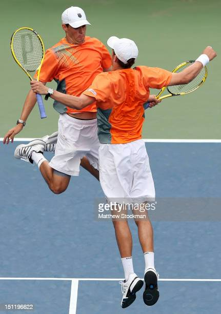 Mike Bryan and Bob Bryan of the United States celebrate as they bump chests during their men's doubles third round match against Santiago Gonzalez of...