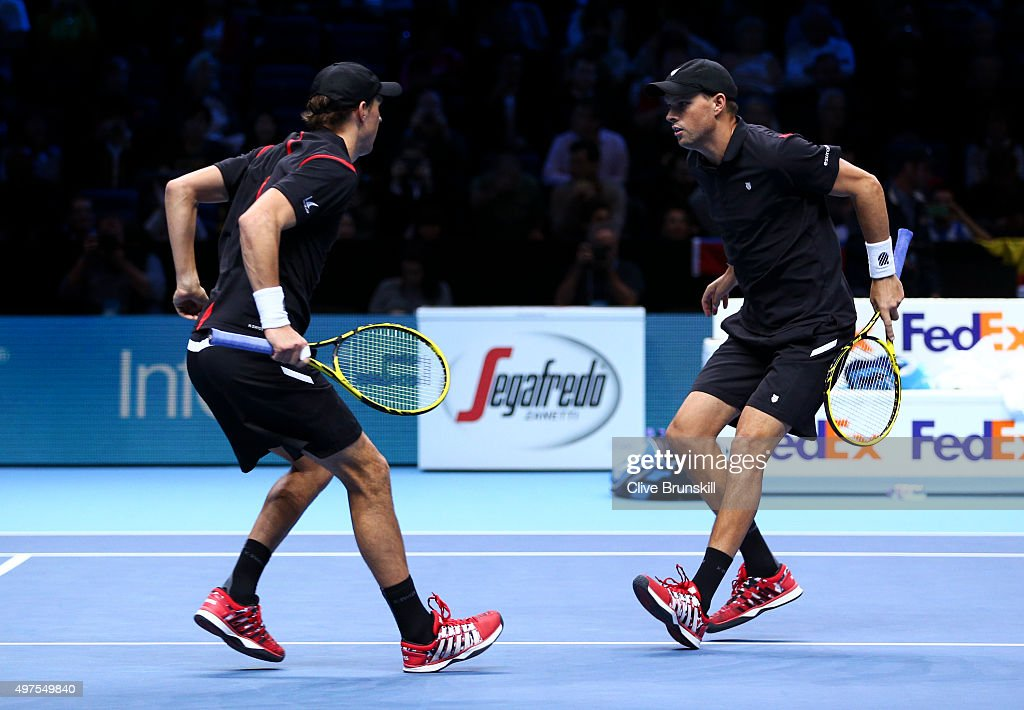 <a gi-track='captionPersonalityLinkClicked' href=/galleries/search?phrase=Mike+Bryan&family=editorial&specificpeople=204456 ng-click='$event.stopPropagation()'>Mike Bryan</a> (L) and <a gi-track='captionPersonalityLinkClicked' href=/galleries/search?phrase=Bob+Bryan&family=editorial&specificpeople=203335 ng-click='$event.stopPropagation()'>Bob Bryan</a> (R) of the United States celebrate their victory in their men's doubles match against Fabio Fognini and Simone Bolelli of Italy during day three of the Barclays ATP World Tour Finals at the O2 Arena on November 17, 2015 in London, England.