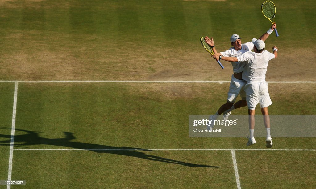 Mike Bryan and Bob Bryan of the United States of America bump chests as they celebrate match point during their Gentlemen's Doubles final match against Ivan Dodig of Croatia and Marcelo Melo of Brazil on day twelve of the Wimbledon Lawn Tennis Championships at the All England Lawn Tennis and Croquet Club on July 6, 2013 in London, England.