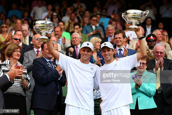 Mike Bryan and Bob Bryan of the United States of America pose with the Gentlemen's Doubles Trophy following their victory in the Gentlemen's Doubles...