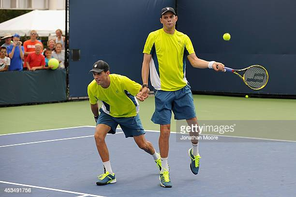 Mike Bryan and Bob Bryan of the United States participate in a doubles exhibition on day three of the Western Southern Open on August 11 2014 in...