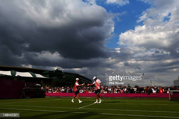 Mike Bryan and Bob Bryan of the United States play against Andre Sa and Thomaz Bellucci of Brazil during their Men's Doubles Tennis match on Day 1 of...