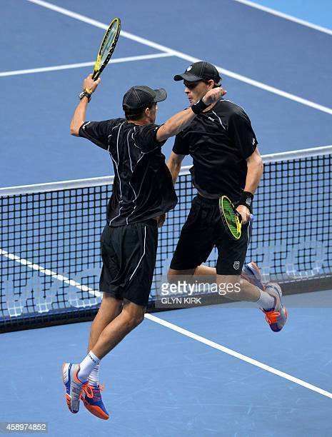 Mike Bryan and Bob Bryan of the US do their trademark chest bump after after winning their Group A doubles match against Austria's Alexander Peya and...