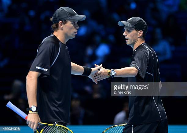 Mike Bryan and Bob Bryan of the US react to a point during their semifinal doubles match against France's Julien Benneteau and France's Edouard...