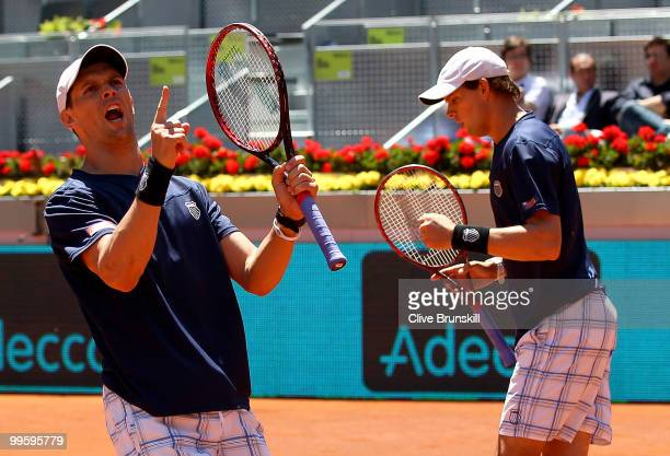Mike Bryan and Bob Bryan of the USA celebrate a point against Daniel Nestor of Canada and Nenad Zimonjic of Serbia in the mens doubles final match...