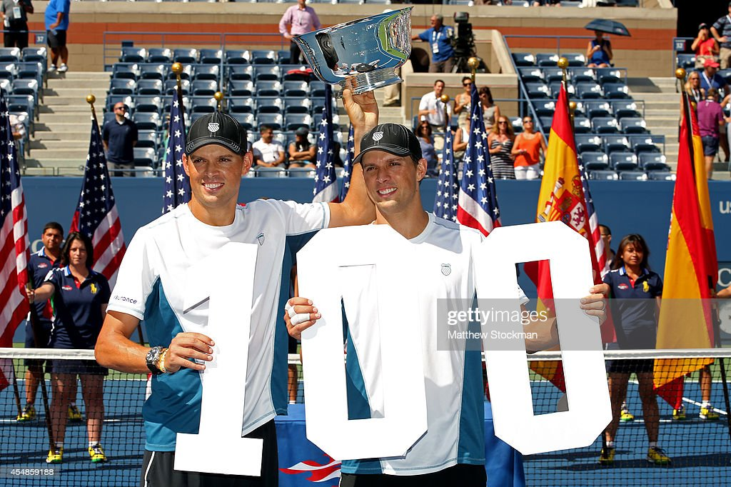 Mike Bryan and Bob Bryan of United States pose with the champions trophy after their 100th career title win after defeating Marcel Granollers and Marc Lopez of Spain in their men's doubles final match on Day fourteen of the 2014 US Open at the USTA Billie Jean King National Tennis Center on September 7, 2014 in the Flushing neighborhood of the Queens borough of New York City. The Bryan brothers defeated Granollers and Lopez in two sets 6-3, 6-4.