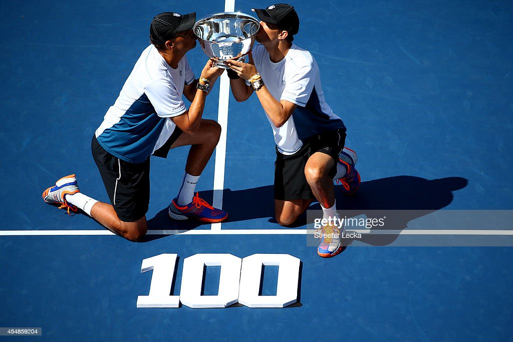 <a gi-track='captionPersonalityLinkClicked' href=/galleries/search?phrase=Mike+Bryan+-+Tennis+Player&family=editorial&specificpeople=204456 ng-click='$event.stopPropagation()'>Mike Bryan</a> and <a gi-track='captionPersonalityLinkClicked' href=/galleries/search?phrase=Bob+Bryan+-+Tennis+Player&family=editorial&specificpeople=203335 ng-click='$event.stopPropagation()'>Bob Bryan</a> of United States pose with the champions trophy after their 100th career title win after defeating Marcel Granollers and Marc Lopez of Spain in their men's doubles final match on Day fourteen of the 2014 US Open at the USTA Billie Jean King National Tennis Center on September 7, 2014 in the Flushing neighborhood of the Queens borough of New York City. The Bryan brothers defeated Granollers and Lopez in two sets 6-3, 6-4.