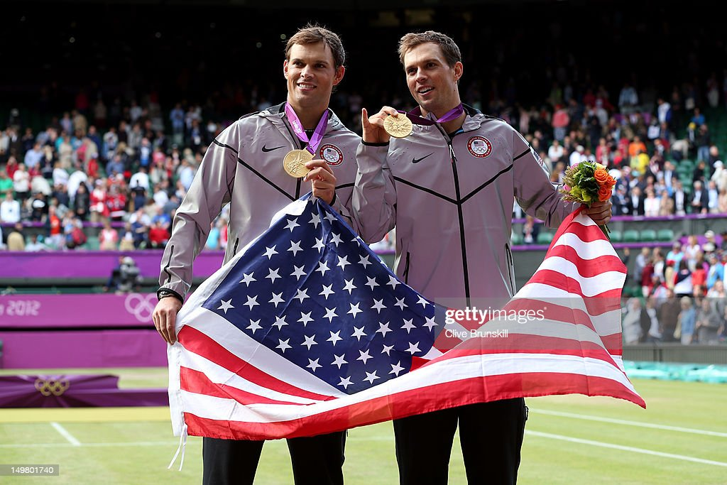 Mike Bryan and Bob Bryan pose with their gold medals and American flag after defeating Jo-Wilfried Tsonga and Michael Llodra of France in their Men's Doubles Tennis final match on Day 8 of the London 2012 Olympic Games at the All England Lawn Tennis and Croquet Club on August 4, 2012 in London, England.