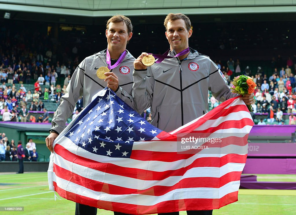 US Mike Bryan and Bob Bryan pose with their gold medals at the end of the London 2012 Olympic Games men's doubles tennis tournament at the All...