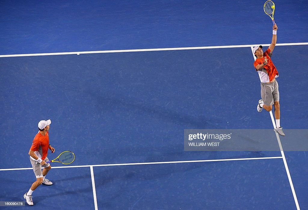 Mike Bryan (R) and his brother Bob of the US compete against the Netherland's Robin Haase and Igor Sijsling during the men's doubles final on day 13 of the Australian Open tennis tournament in Melbourne on January 26, 2013.